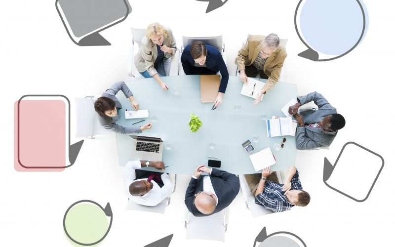 Group Of Business People Meeting With Speech Bubbles
